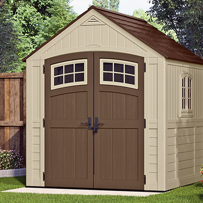 A finished DIY shed resting on a concrete slab.