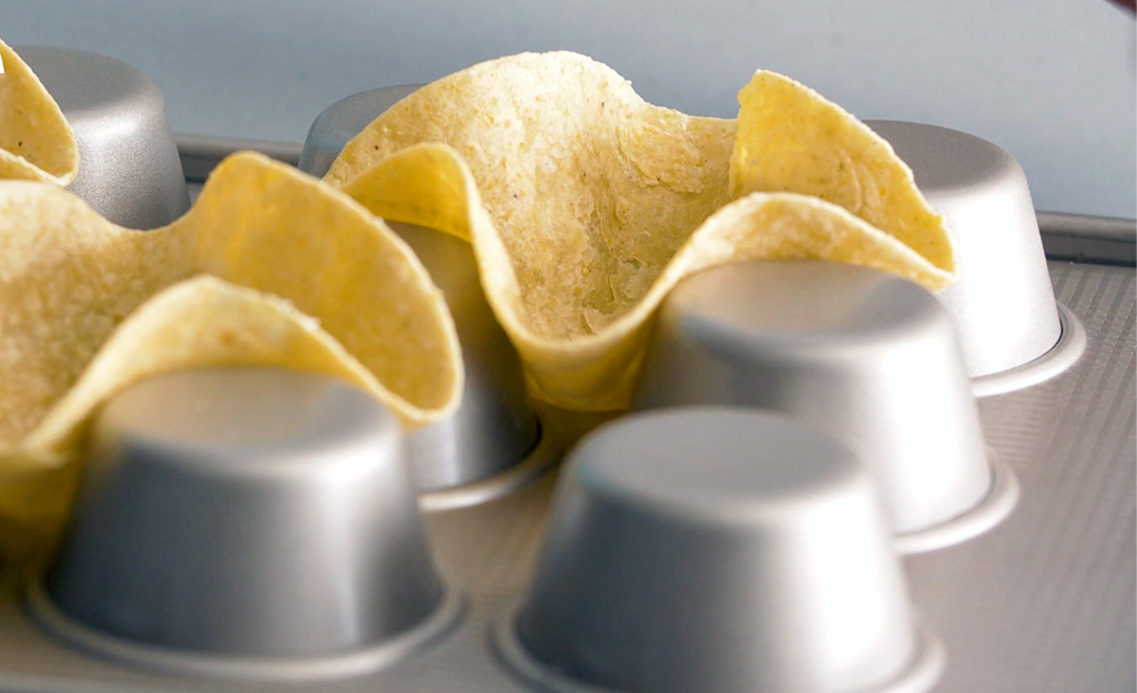 Tortilla shells baked on the back of a muffin tin.
