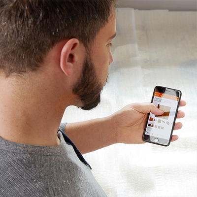 A man uses the image search feature on The Home Depot app.