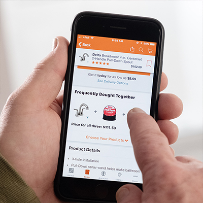 A person uses The Home Depot app to buy a product.