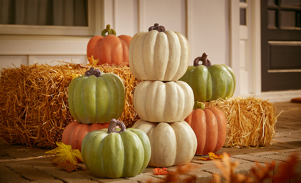 Decorative pumpkins gathered on a porch.