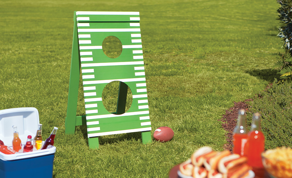 A backyard features games, a cooler and other ways to host.