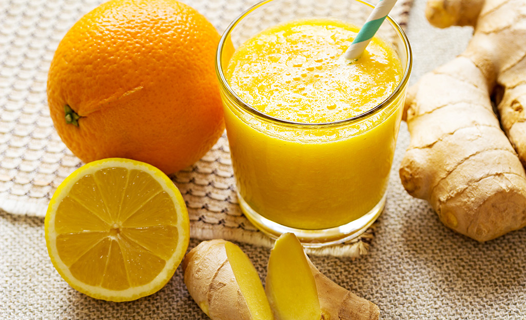 Ginger root with glass of orange juice