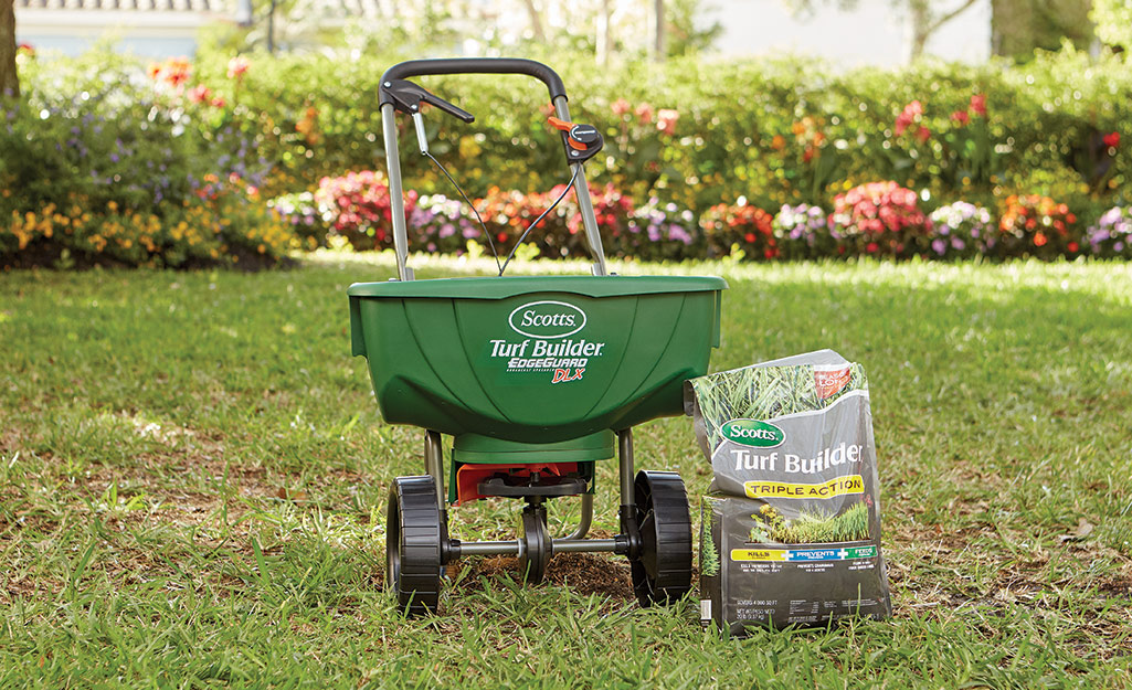 Spreader with weed and feed product