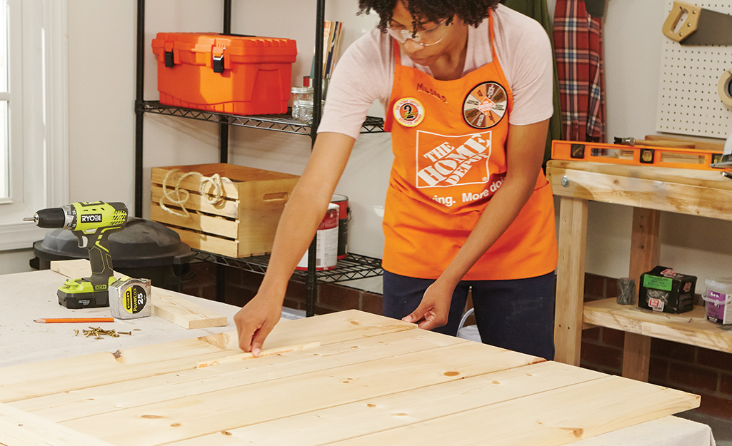 a woman assembling pieces of plywood together