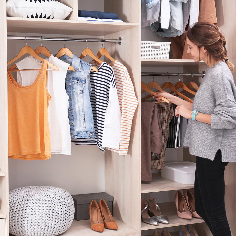 Someone organizing a walk-in closet.