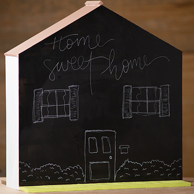 A finished dollhouse with chalkboard MDF facade.