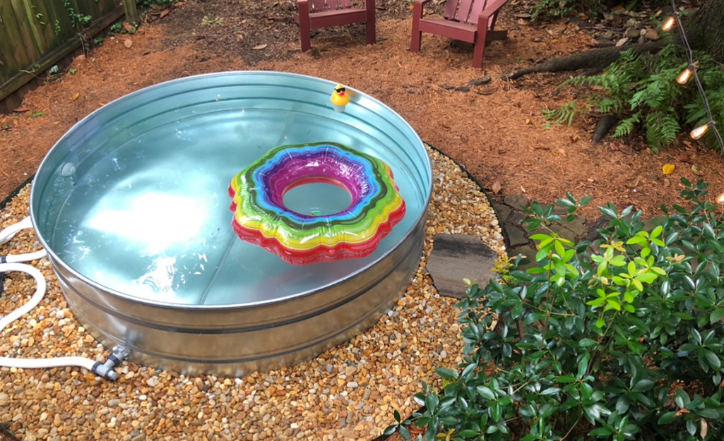 A swimming tube floating in a stock tank pool.