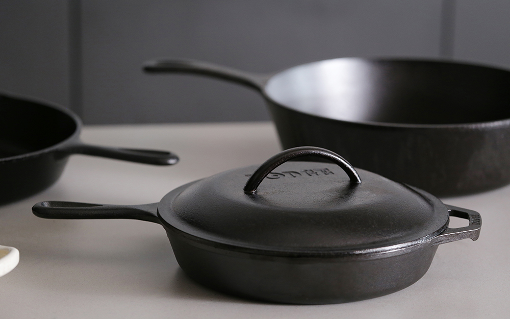 A collection of cast-iron skillets.