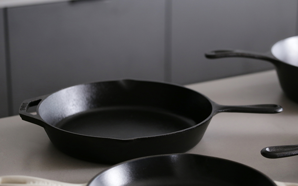 A cast-iron skillet on a countertop.