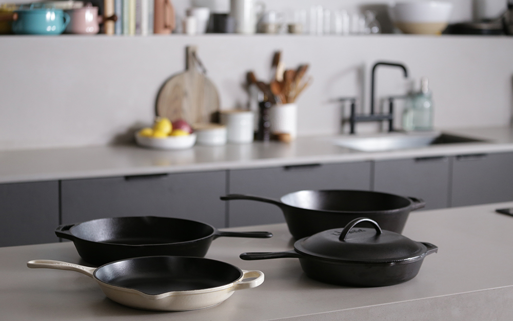 An enameled cast-iron pan with other cast-iron cookware.