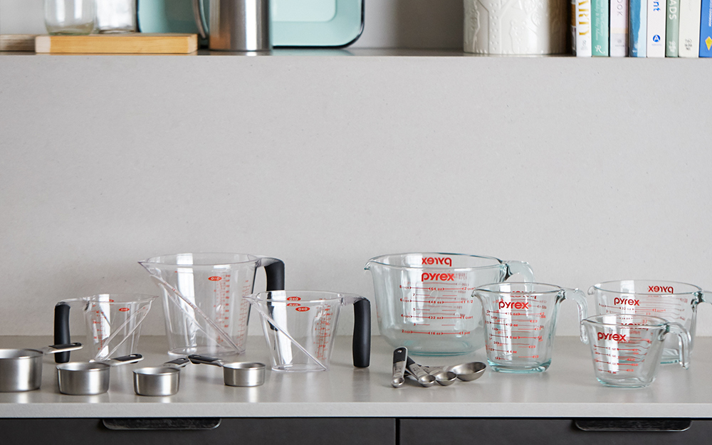 an assortment of measuring cups and spoons