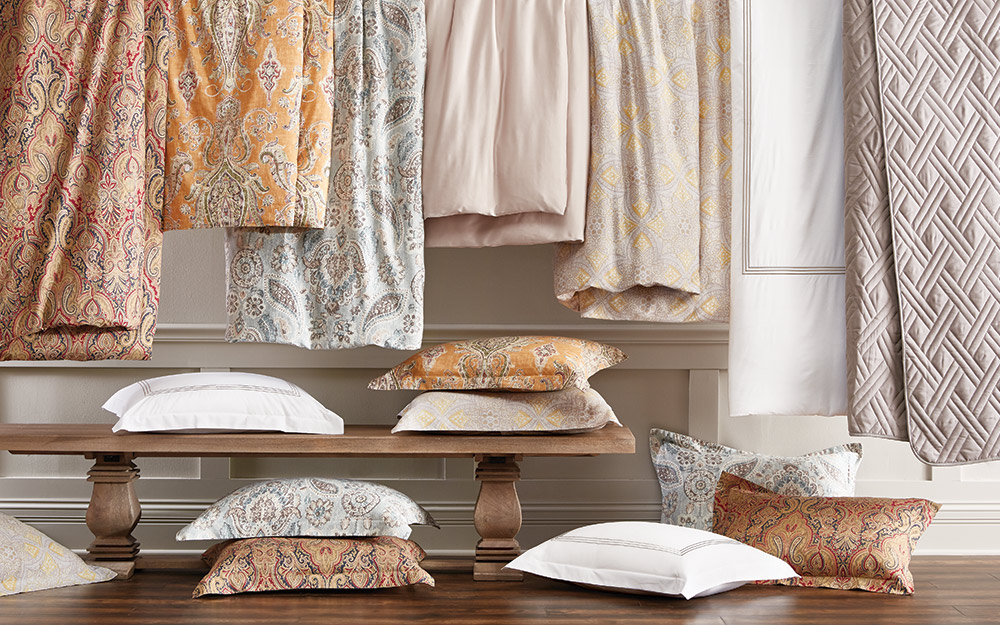 A collection of quilts, comforters and decorative pillows