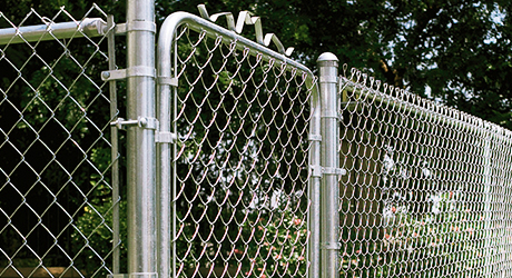 A finished chain link fence with gate
