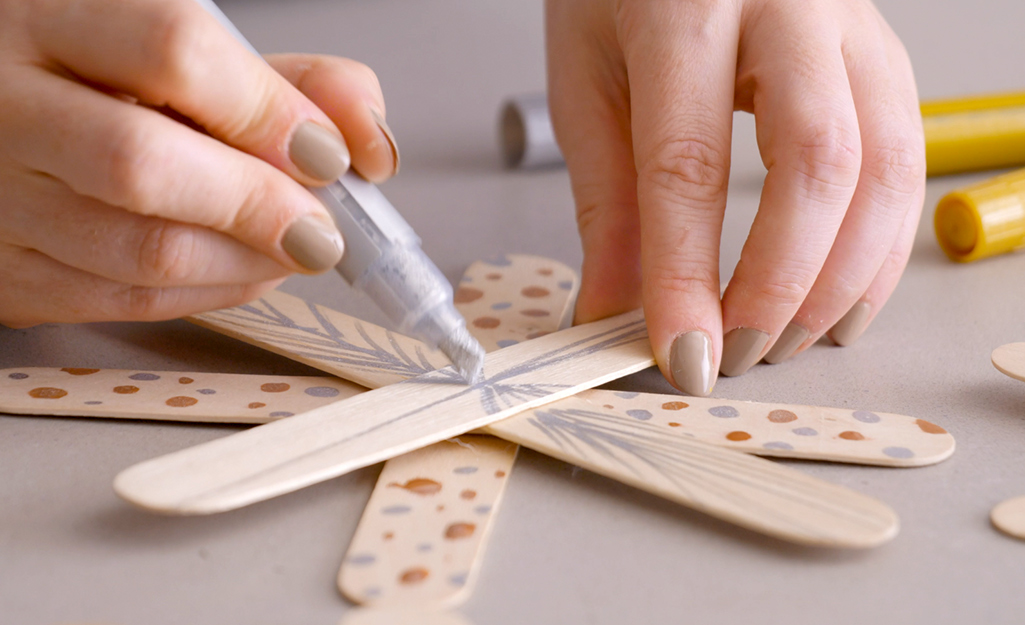 Metallic markers are used to create star ornaments.