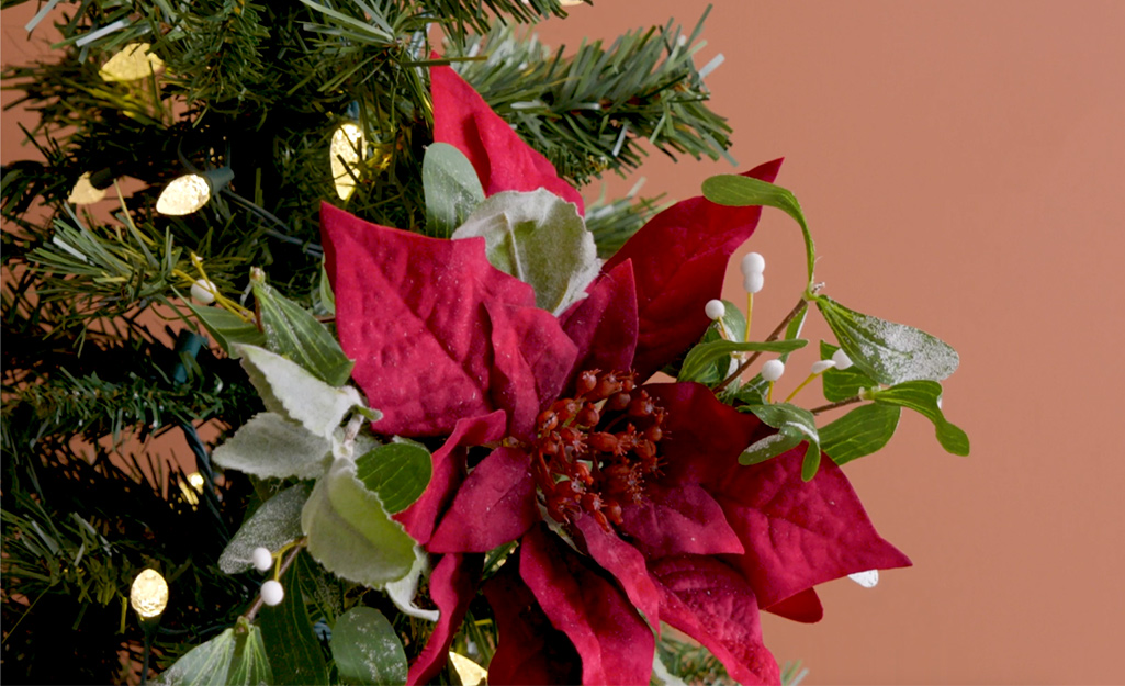 A finished poinsettia holiday bouquet ornament.