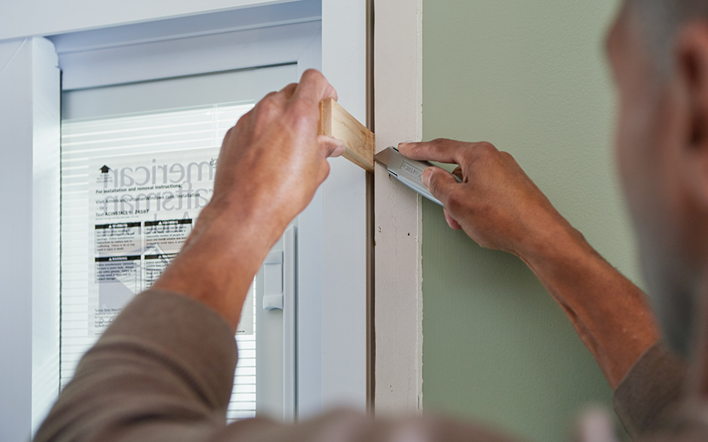 A man securing a sliding door in place