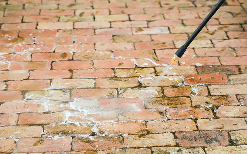 Apply detergent - How to Clean Brickwork