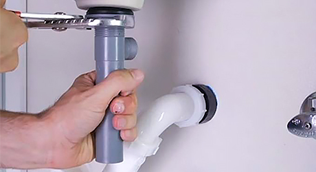 Tighten locknut turn drain - Install Pop-Up Drain