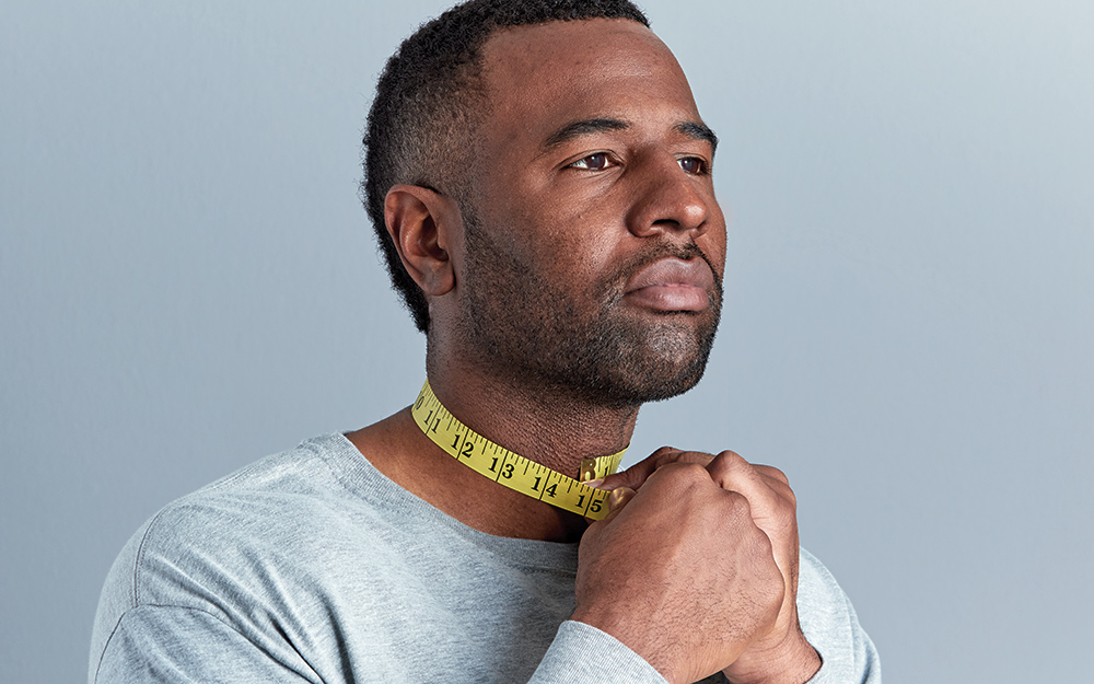 A person measures the circumference of their neck.
