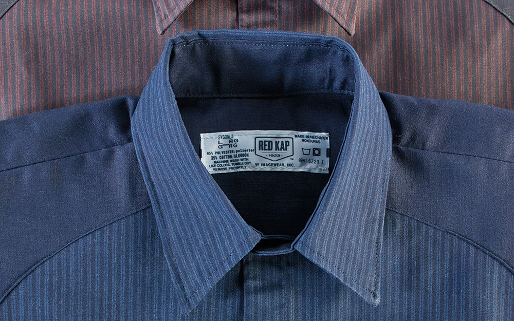 A work shirt with the sizing tag visible.