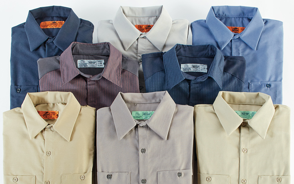 An assortment of button-up work shirts in various sizes.