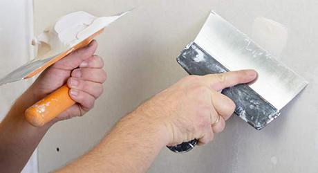 Scrape away loose paint putty knife - Patch Peeling Paint