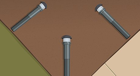 Illustration of three landscape lights surrounding a patch of dirt.