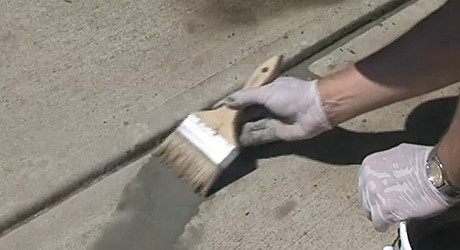 Wet surface and apply concrete agent - Minor Sidewalk Repairs
