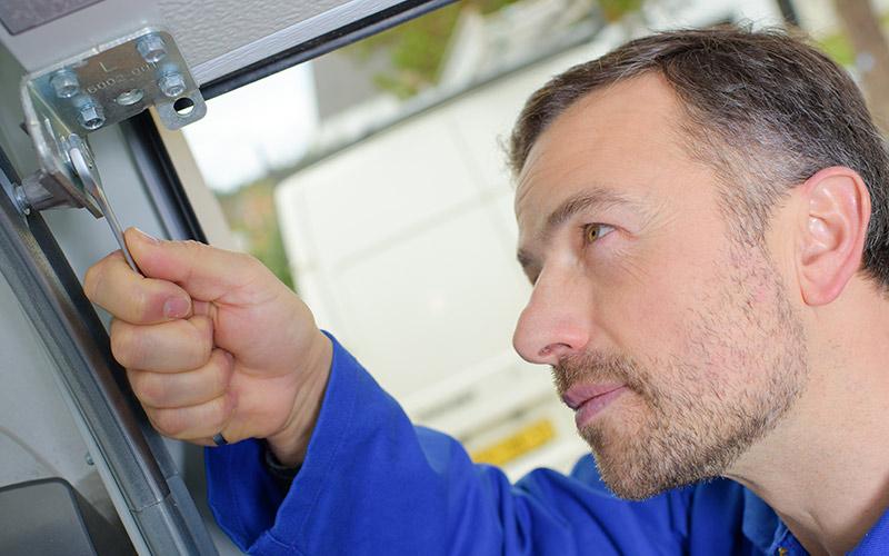 Reduce friction between door - Garage Door Maintenance Tips