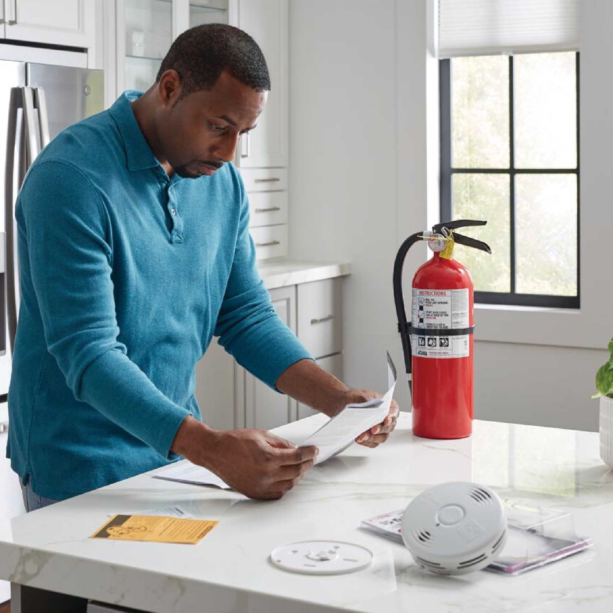 A man reviews fire extinguisher instructions.