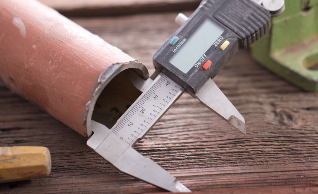 A caliper measuring a pipe