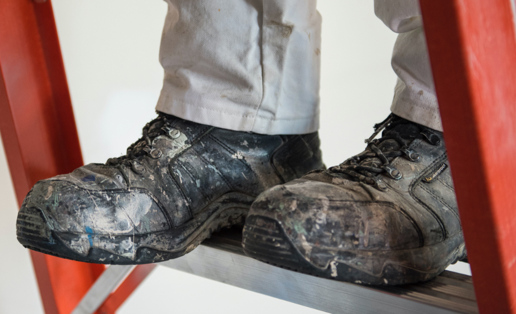 A Pro wears work shoes on a ladder