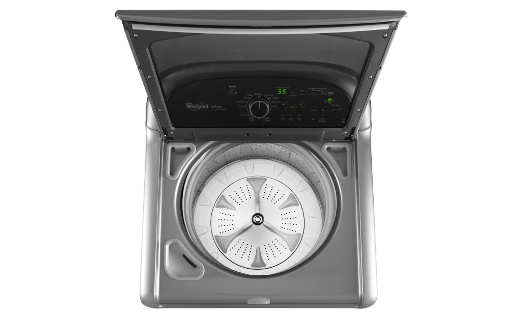 A Whirlpool top-load washing machine with the lid open.