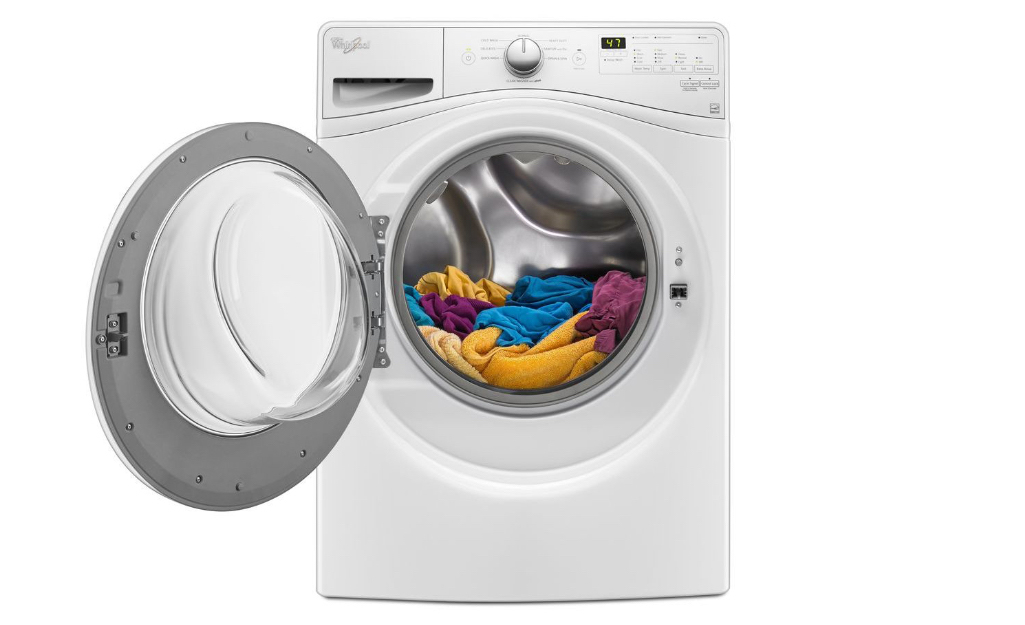 A front-loading Whirlpool washer with the door open.