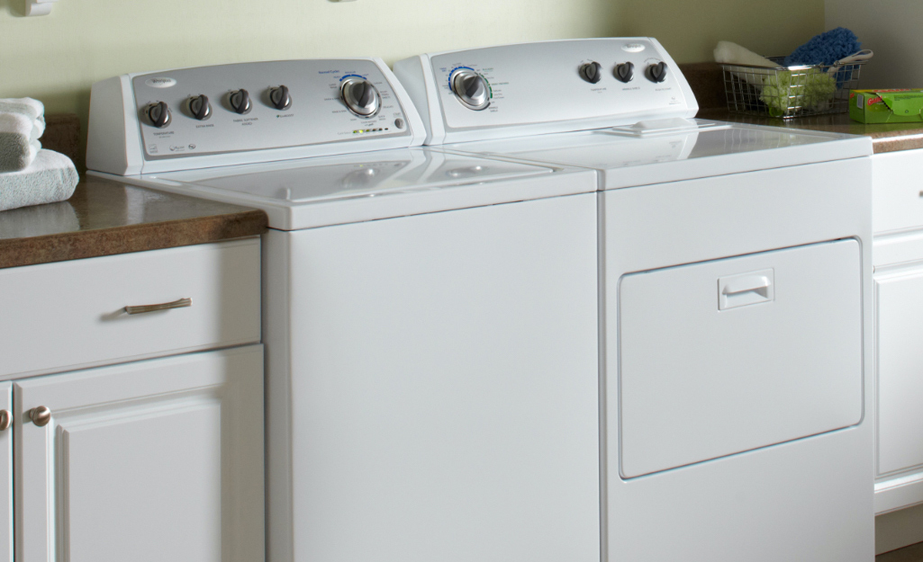 A Whirlpool washer/dryer in a laundry room.
