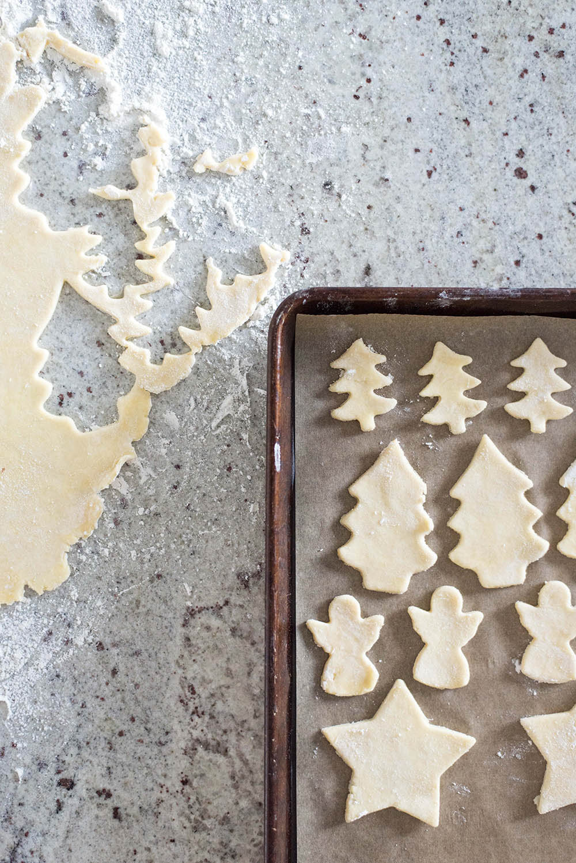 Various shapes of dough on a baking sheet.