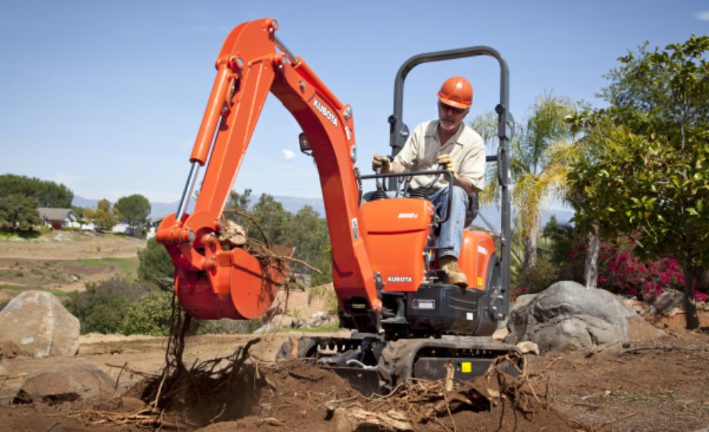 Worker in Mini Excavator