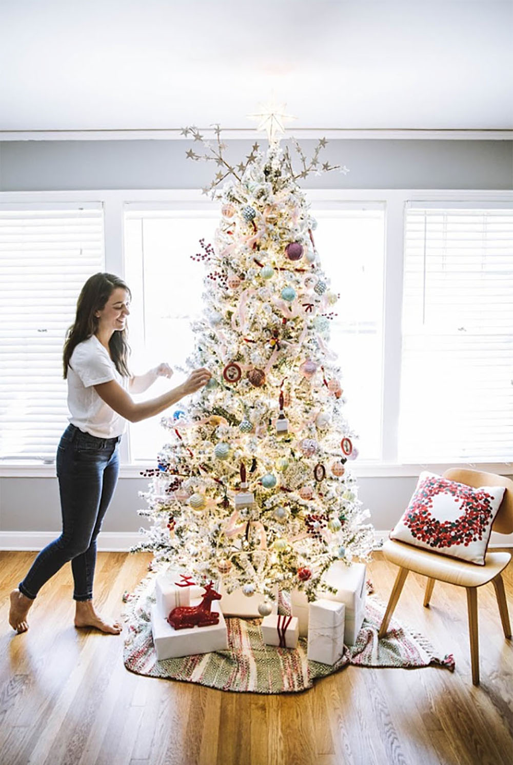 A woman decorating a Christmas Tree.
