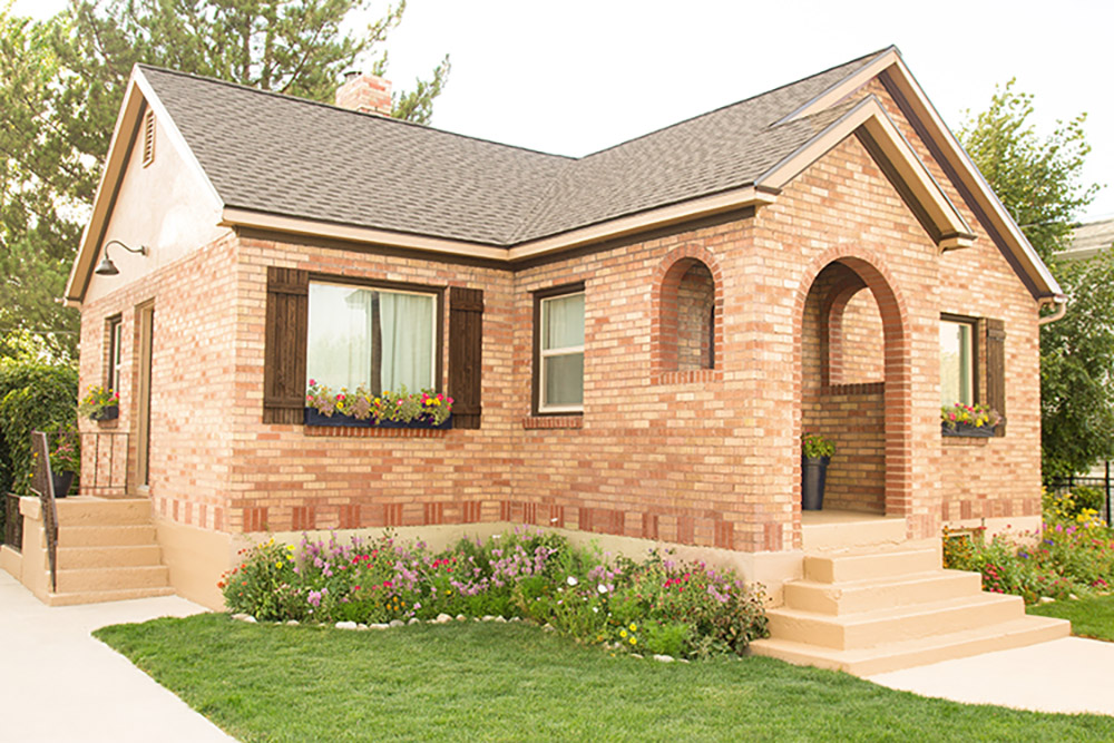 The front of a brick home with a new roof.