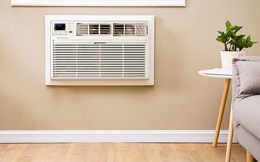 A built-in air conditioner in the wall of a living room.