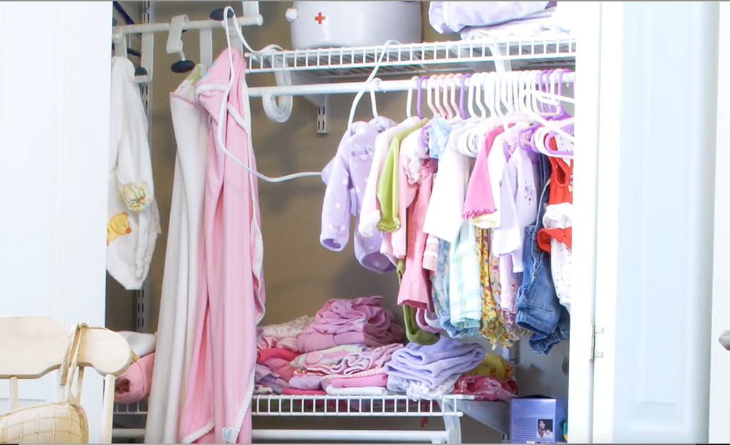 Wire shelving is used to organize a baby's closet.