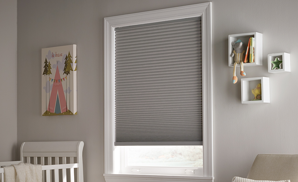 Safety blinds are hung in a nursery.