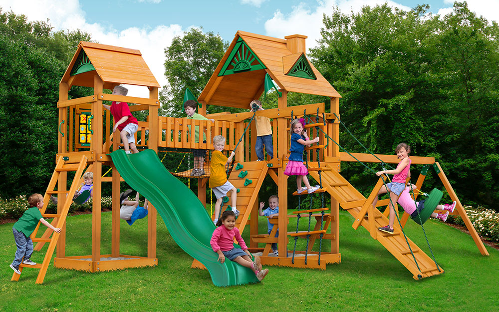 Children playing on a wood playset.