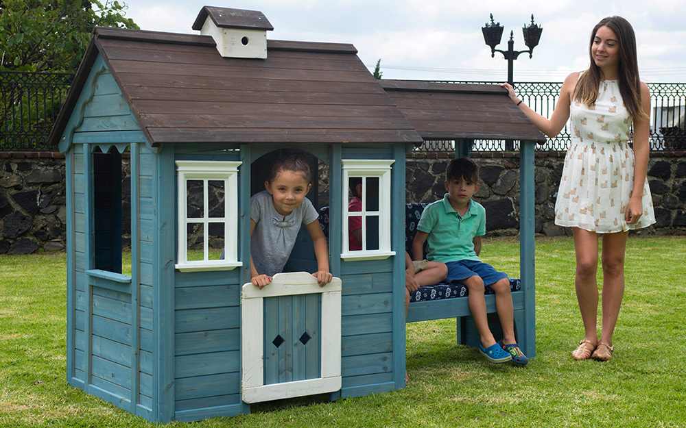 Children playing with a playhouse.