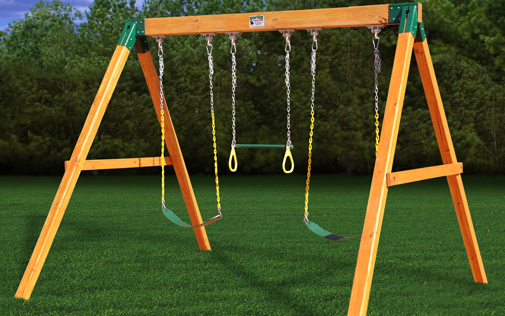 Children playing on a swing set.
