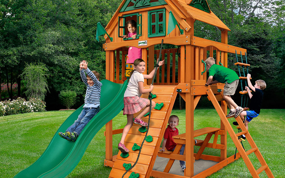 Children playing on a wooden playset.