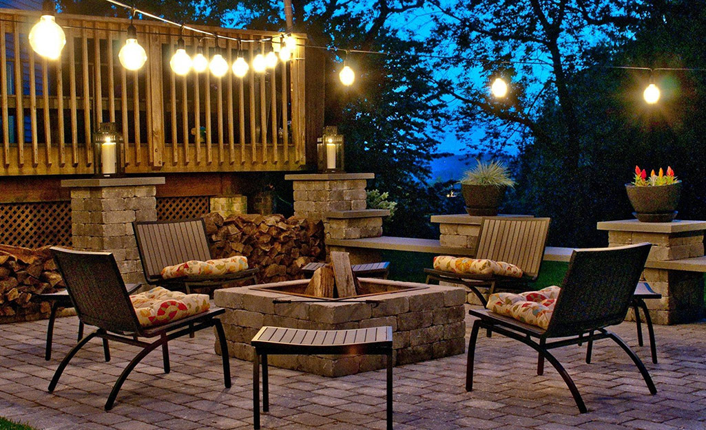 String lights illuminating a patio.
