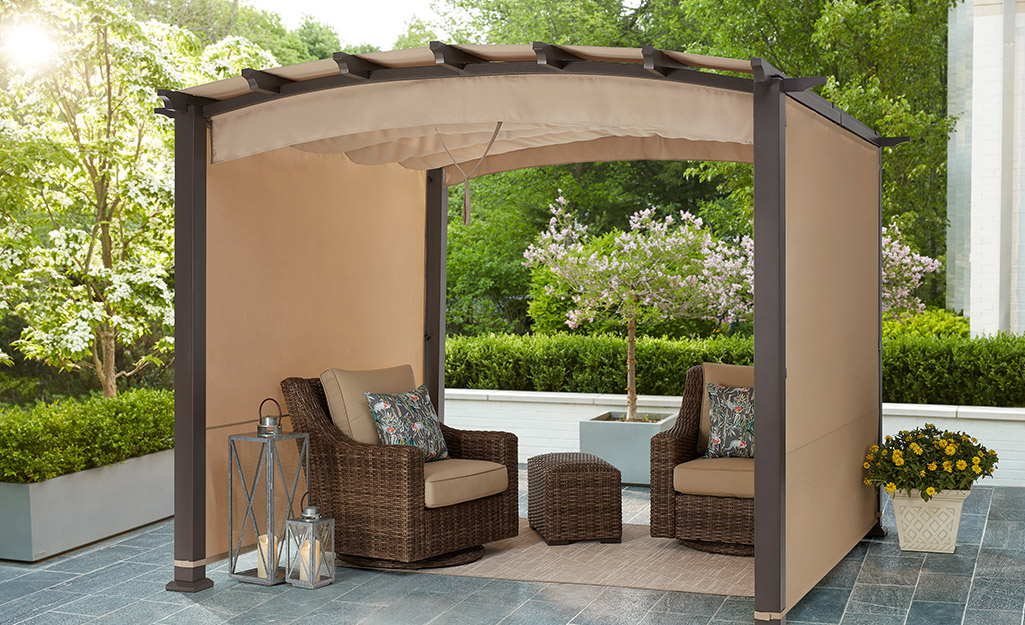 An outdoor seating area shaded by a pergola.
