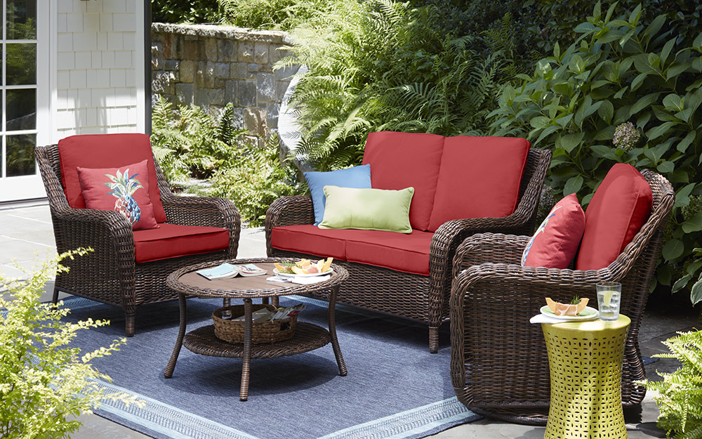 Outdoor furniture with red cushions.